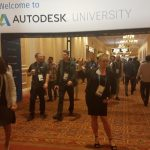 April McCall at the Welcome to Autodesk University banner
