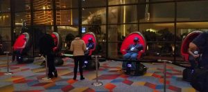 people sitting in pods for vr walk on mars experience