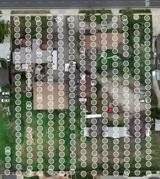 drone image showing the orthomosaic map of aerial photos taken over plot of land.
