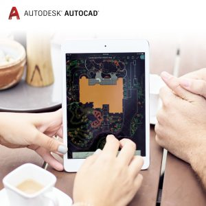 AutoCAD web and mobile are shown on a tablet sitting on a picnic table being shared between two people.