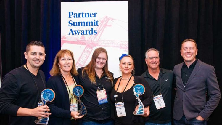 Kelar Pacific receiving Gold Partner awards at XCON 2019 with Marissa Walton and Steve Jones