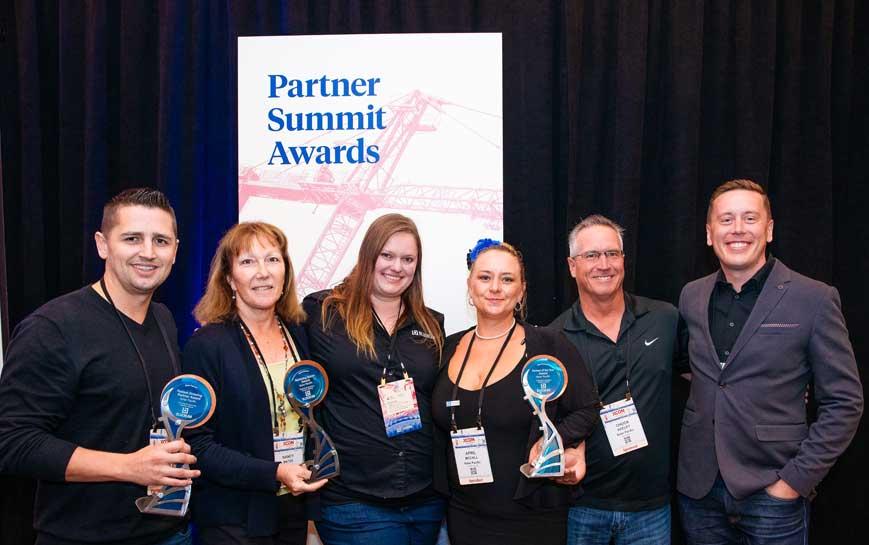 Kelar Pacific receiving Gold Partner awards at XCON 2019 with Marissa Walton and Steve Jones