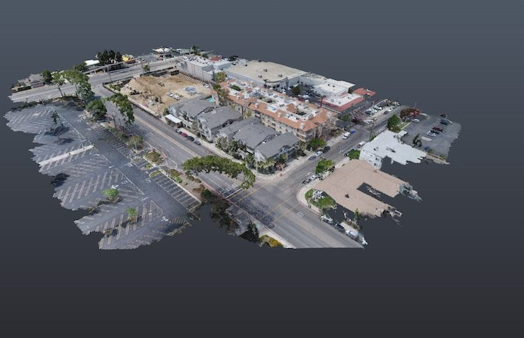 Drone scan of a multi-story building and surrounding streets