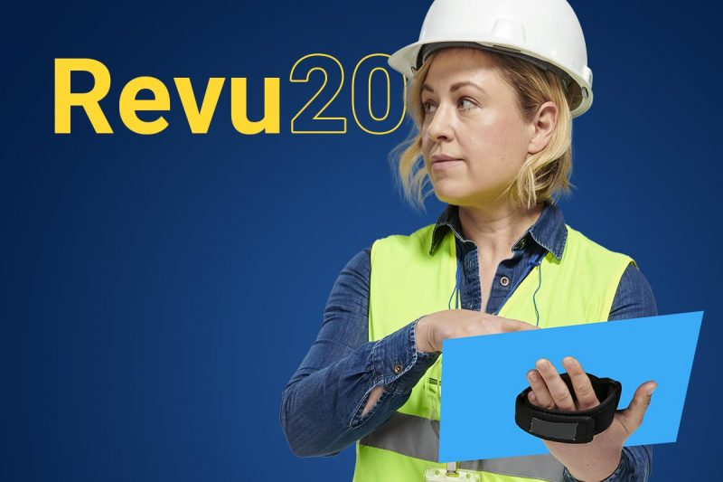 Revu 20 image with woman in construction vest holding a tablet.