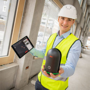 construction guy holding a Leica BLK360 and a tablet showing the scanning locations.